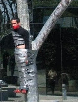 MAN TIED TO TREE